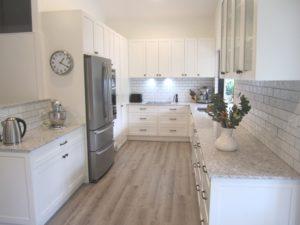 Robinson Chapel Hill Shaker Style Kitchen in Resene Rice Cake with Caesarstone Alantic Salt Benchtops