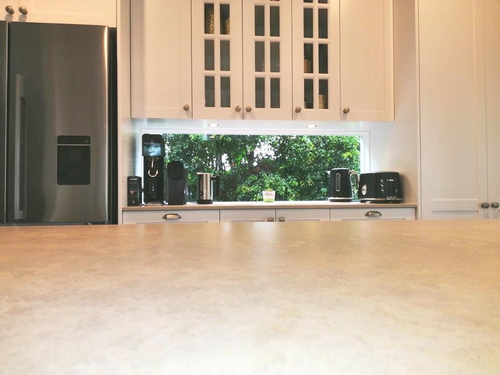 Holland Park Shaker Kitchen with Caesarstone Primordia Benchtops and Glass Splashback Window